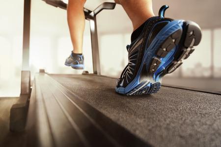 Blue Sneakers running on treadmill